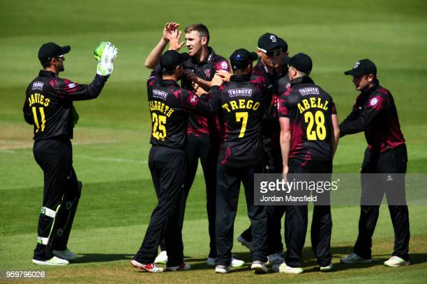 Craig Overton of Somerset celebrates with his teammates after dismissing Will Jacks of Surrey during the Royal London OneDay Cup match between Surrey...