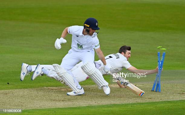 Craig Overton of Somerset dives to attempt to run out Joe Weatherley of Hampshire during day one of the LV= County Championship match between...