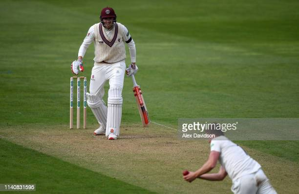 Craig Overton of Somerset watches on as Harry Podmore of Kent catches him during Day 2 of the Specsavers County Championship match between Somerset...