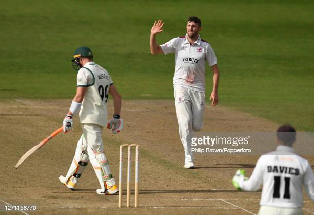 Craig Overton of Somerset waves to departing batsman Riki Wessels of Worcestershire after dismissing him during the Bob Willis Trophy match at New...