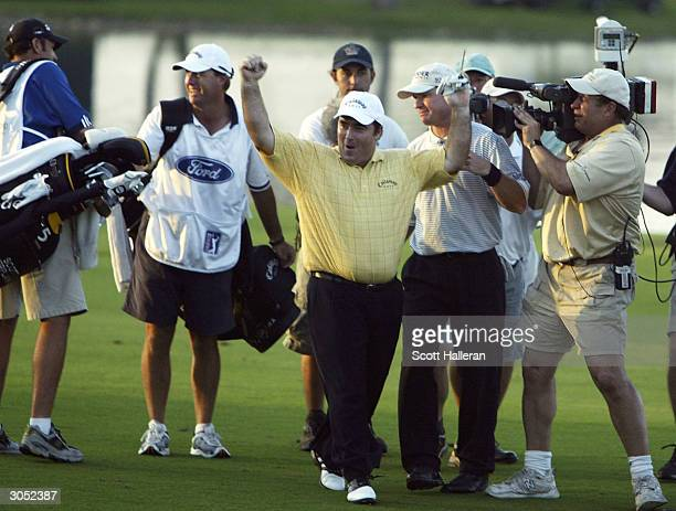 Craig Parry of Australia celebrates after holing a shot for eagle to defeat Scott Verplank on the first playoff hole at the Ford Championship at the...