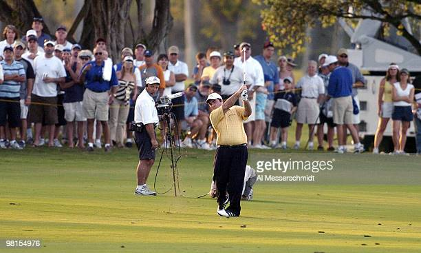 Craig Parry of Australia fires a six-iron from 176 yards to end the final round of the PGA Tour Ford Championship at Doral in Miami, Florida March 7,...