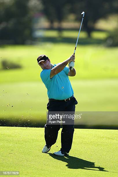 Craig Parry of Australia hits an iron shot during the Pro-Am ahead of the 2012 Australian Open, beginning tomorrow, at The Lakes Golf Club on...