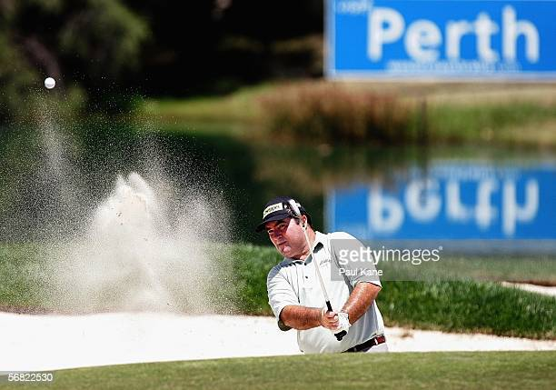 Craig Parry of Australia plays a shot out of a bunker on the 16th during day three of the Johnnie Walker Classic held at The Vines Resort February...