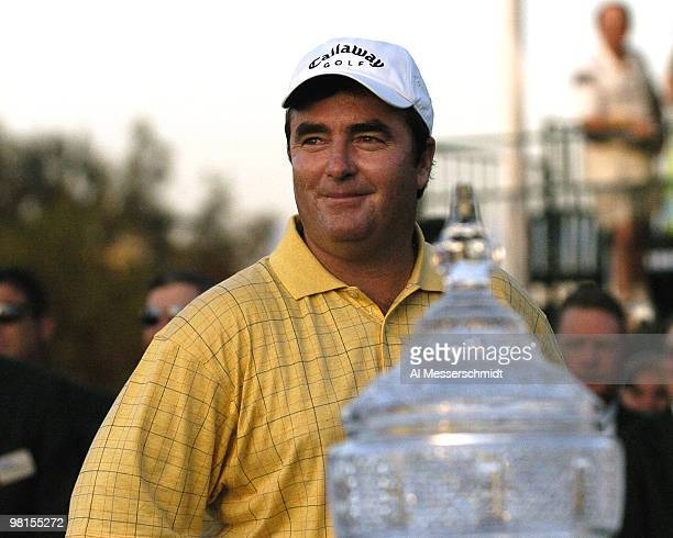 Craig Parry of Australia poses with the winner's trophy after the final round of the PGA Tour Ford Championship at Doral in Miami, Florida March 7,...