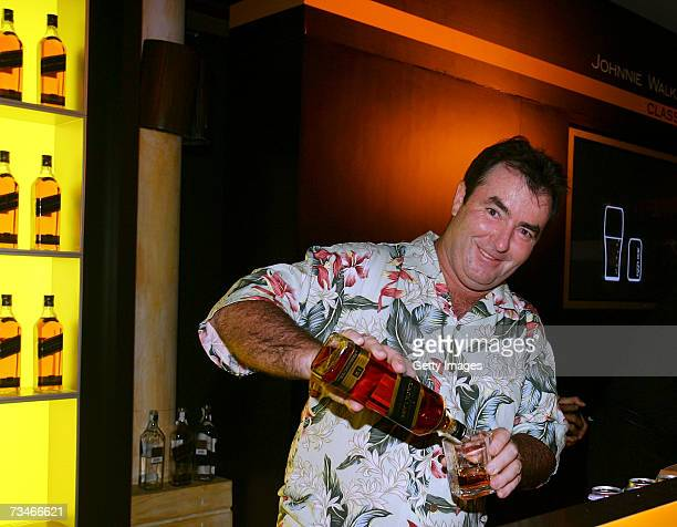 Craig Parry of Australia pours Johnnie Walker Black Label for the invited guests at the Johnnie Walker 'Golfers Behind the Bar' event held at the...