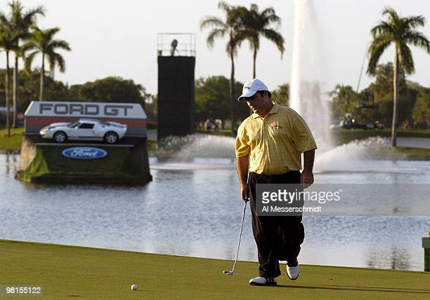 Craig Parry of Australia sets to putt on the 18th green in the final round of the PGA Tour Ford Championship at Doral in Miami, Florida March 7,...