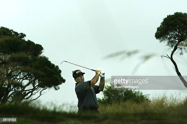 Craig Parry of Australia tees off on the 5th hole during the 2003 Australian Open Golf Tournament on December 18, 2003 at Moonah Links in Melbourne,...