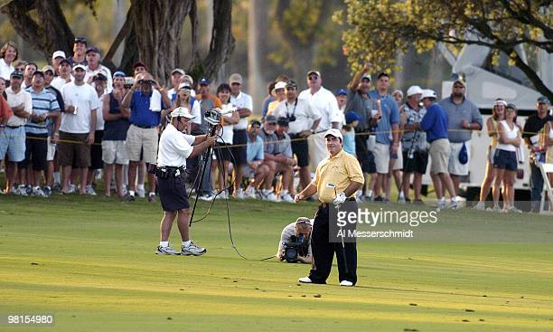 Craig Parry of Australia tosses his club and dances to end the final round of the PGA Tour Ford Championship at Doral in Miami, Florida March 7,...