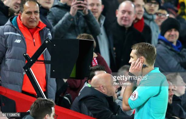 Craig Pawson match referee watches the VAR screen before awarding a penalty to Liverpool during The Emirates FA Cup Fourth Round match between...