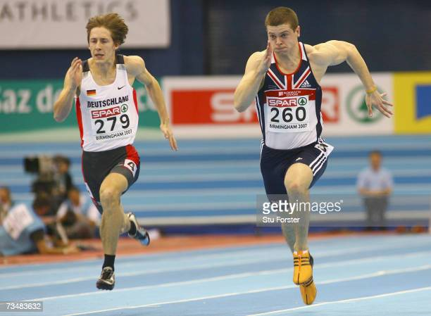 Craig Pickering of Great Britain competes with Christian Blum of Germany during the Men's 60 Metres Semifinal on day two of the 29th European...
