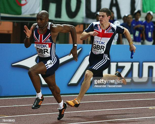 Craig Pickering of Great Britain prepares to hand the baton to team mate Marlon Devonish during the Men's 4 x 100m Relay on day eight of the 11th...