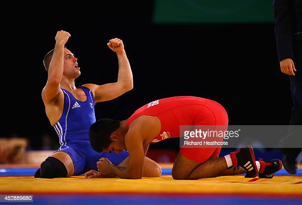 Craig Pilling of Wales celebrates beating Omar Tafail of England in the 57kg Freestyle Wrestling Bronze medal match at Scottish Exhibition And...