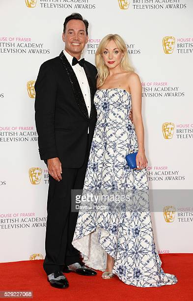 Craig Revel Horwood and Helen George pose for a photo in the winners room during the House Of Fraser British Academy Television Awards 2016 at the...