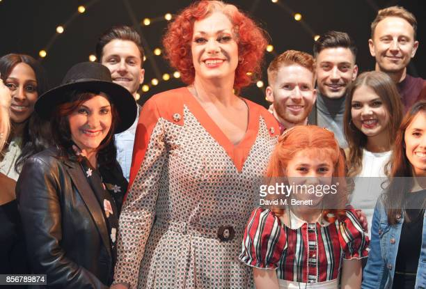Craig Revel Horwood and Ruby Stokes pose backstage with Strictly Come Dancing cast including Alexandra Burke Shirley Ballas Brian Conley Neil Jones...