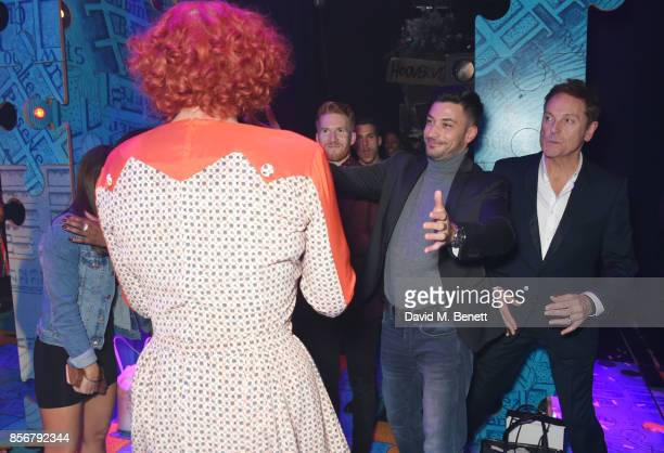 Craig Revel Horwood is congratulated by Strictly Come Dancing cast members Neil Jones Gorka Marquez and Brian Conley backstage following the cast...