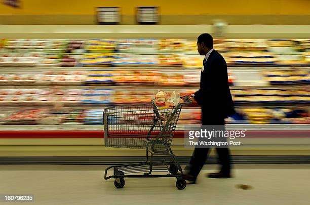Craig Rice Vice President of the Montgomery County Council walks along a meat and dairy section that for the most part he had to avoid for budget...