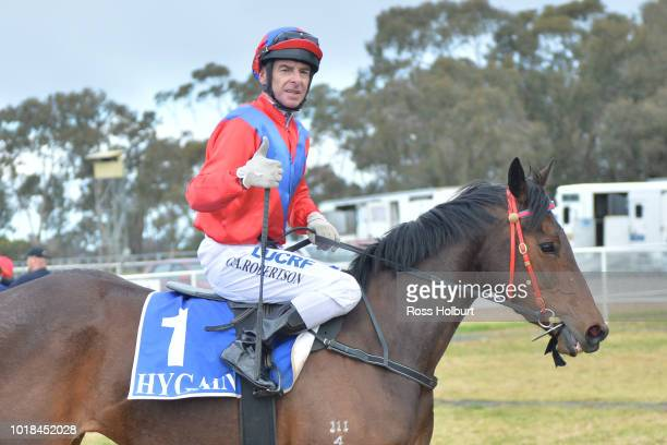 Craig Robertson returns to the mounting yard on All About Alice after winning the Rushton Park FM Maiden Plate at Tatura Racecourse on August 18 2018...