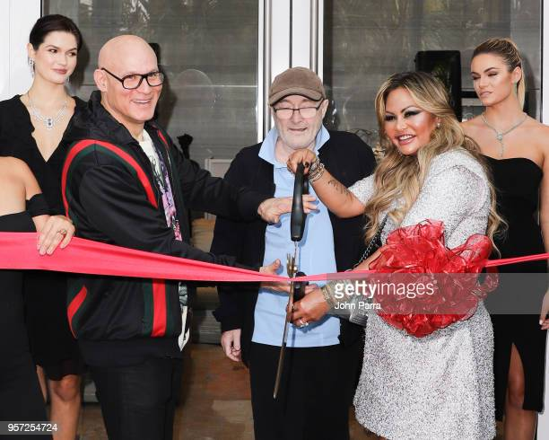 Craig Robins Phil Collins Orianne Collins and Renata Munoz cut the red ribbon at Orianne Collins Jewellery Grand Opening on May 10 2018 in Miami...