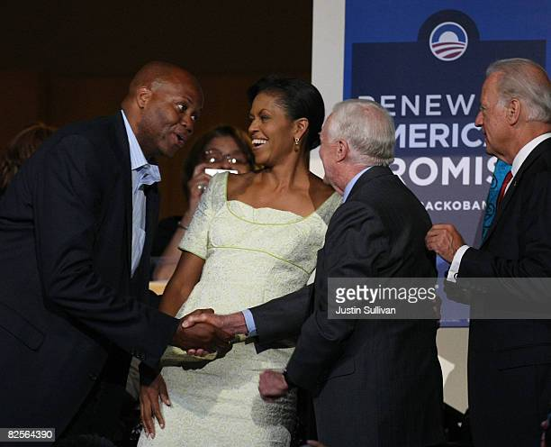 Craig Robinson and his sister Michelle Obama wife of presumptive Democratic nominee US Sen Barack Obama greet Former US President Jimmy Carter as...