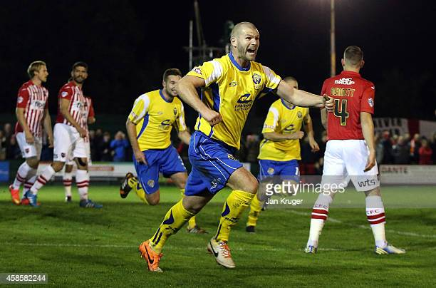 Craig Robinson of Warrington Town heads celebrates the opening goal during the FA Cup First Round match between Warrington Town and Exeter City at...