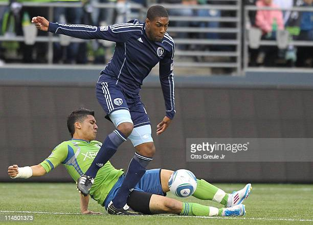 Craig Rocastle of Sporting Kansas City dribbles over Fredy Montero of the Seattle Sounders FC at Qwest Field on May 21 2011 in Seattle Washington The...