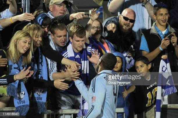 Craig Rocastle of the Sporting KC greets his supporters after they played to a 11 tie with the Colorado Rapids at Dick's Sporting Goods Park on May...