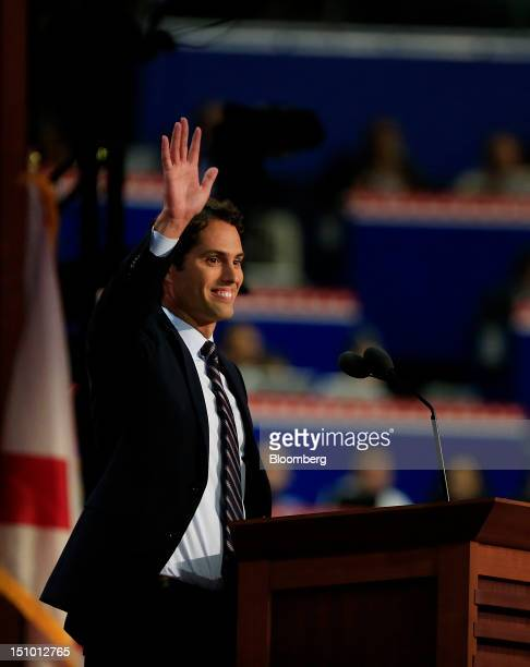 Craig Romney son of Republican presidential candidate Mitt Romney waves before speaking at the Republican National Convention in Tampa Florida US on...