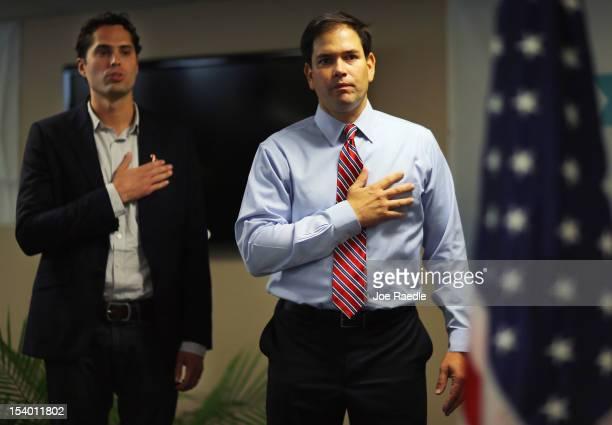 Craig Romney the son of Republican presidential candidate former Massachusetts Gov Mitt Romney and Sen Marco Rubio recite the Pledge of Allegiance at...