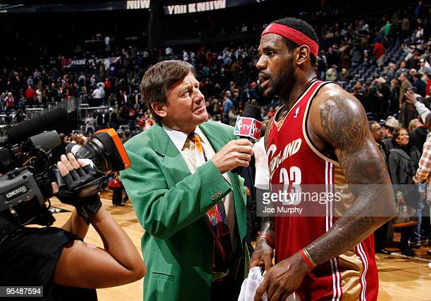 Craig Sager broadcaster for NBA TV interviews LeBron James of the Cleveland Cavaliers after a win against the Atlanta Hawks on December 29 2009 at...