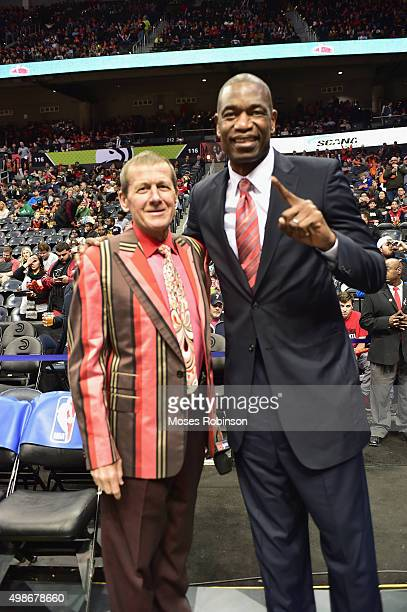 Craig Sager II and former NBA player Dikembe Mutombo attend Boston Celtics vs Atlanta Hawks game where Former NBA Player and Hall of Famer Dikembe...