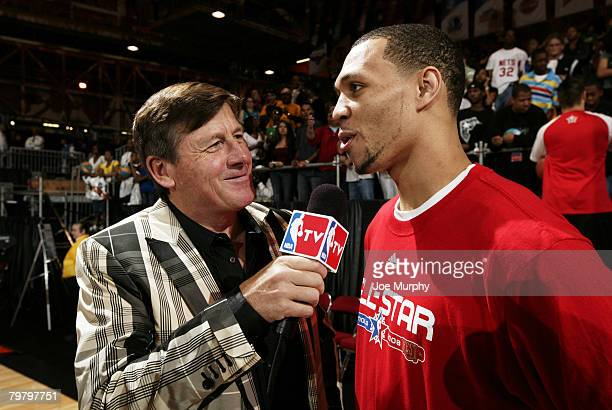 Craig Sager of NBA TV interviews Brandon Roy of the West AllStars during the West AllStar Practice on center court during NBA Jam Session Presented...