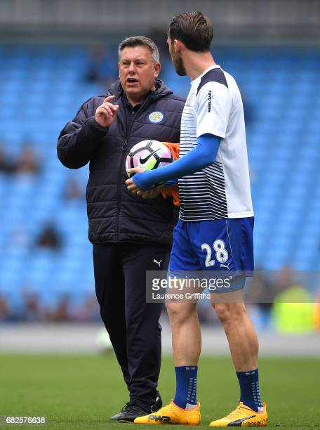 Craig Shakespeare, manager of Leicester City and Christian Fuchs of Leicester City speak on the pitch during the warm up prior to the Premier League...