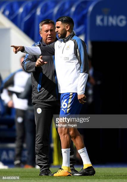 Craig Shakespeare manager of Leicester City and Riyad Mahrez of Leicester City speak prior to the Premier League match between Leicester City and...