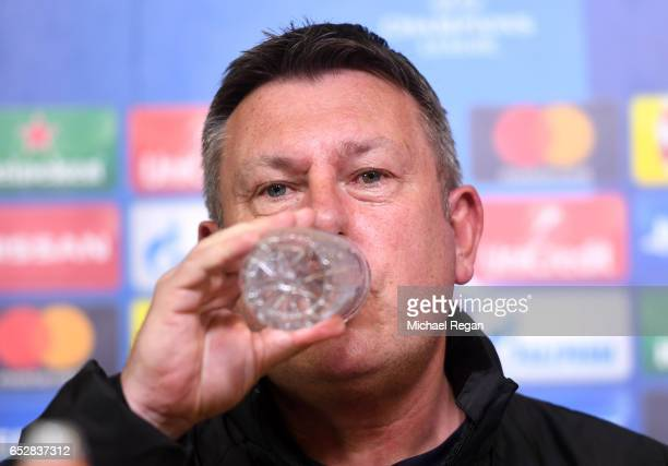 Craig Shakespeare, Manager of Leicester City drinks water during a press conference ahead of their UEFA Champions League Round of 16 match against...