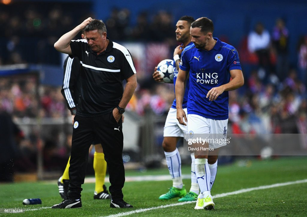 Craig Shakespeare, Manager of Leicester City scratches his head after talking with Danny Drinkwater during the UEFA Champions League Quarter Final first leg match between Club Atletico de Madrid and Leicester City at Vicente Calderon Stadium on April 12, 2017 in Madrid, Spain.