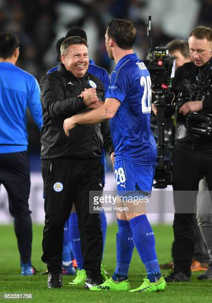 Craig Shakespeare the interim Manager of Leicester City and Christian Fuchs of Leicester City celebrate their team's 32 agg victory following the...