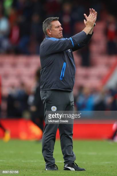 Craig Shakespeare the manager of Leicester applauds the travelling supporters after his side's 00 draw during the Premier League match between AFC...
