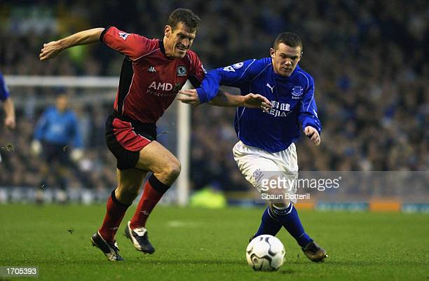 Craig Short of Blackburn Rovers tussles with Wayne Rooney of Everton for possession of the ball during the FA Barclaycard Premiership match between...