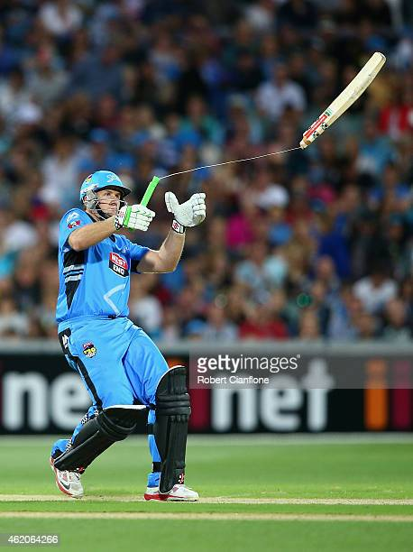 Craig Simmons of the Strikers breaks his bat as he plays a shot during the Big Bash League Semi Final match between the Adelaide Strikers and the...