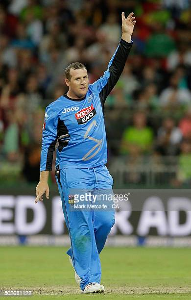Craig Simmons of the Strikers celebrates taking the wicket of Aiden Blizzard of the Thunder during the Big Bash League match between the Sydney...
