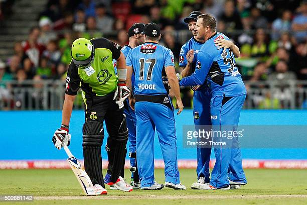 Craig Simmons of the Strikers celebrates with team mates after claiming the wicket of Aiden Blizzard of the Thunder during the Big Bash League match...