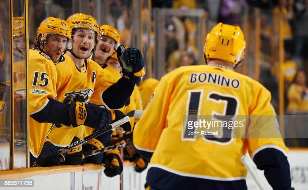 Craig Smith and Filip Forsberg celebrate a goal by Nick Bonino of the Nashville Predators against the Vancouver Canucks during an NHL game at...