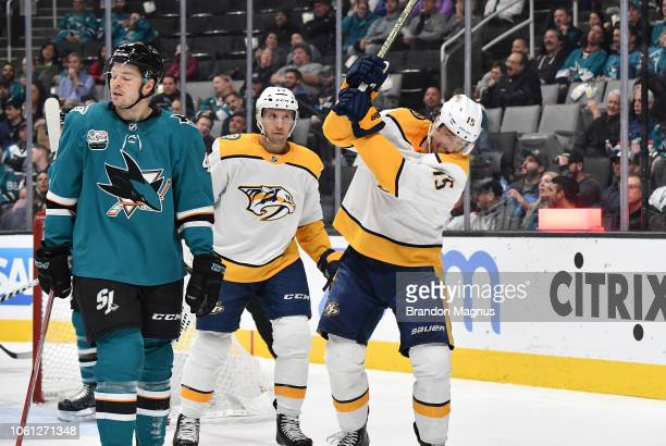 Craig Smith and Nick Bonino of the Nashville Predators celebrate a goal in front of Tomas Hertl of the San Jose Sharks at SAP Center on November 13...