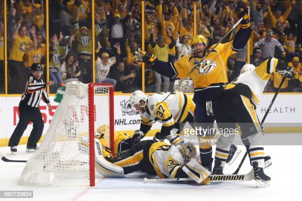 Craig Smith celebrates after Calle Jarnkrok of the Nashville Predators scored a goal against Matt Murray of the Pittsburgh Penguins during the first...