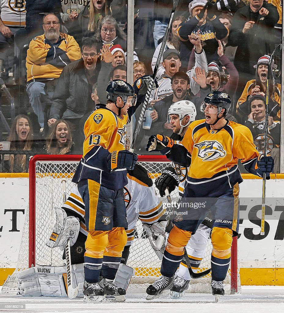 Craig Smith #15 celebrates his goal with Nick Spaling #13 of the Nashville Predators against the Boston Bruins at Bridgestone Arena on December 23, 2013 in Nashville, Tennessee.