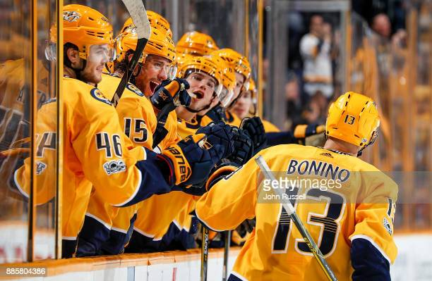 Craig Smith congratulates Nick Bonino of the Nashville Predators on his goal against the Boston Bruins during an NHL game at Bridgestone Arena on...