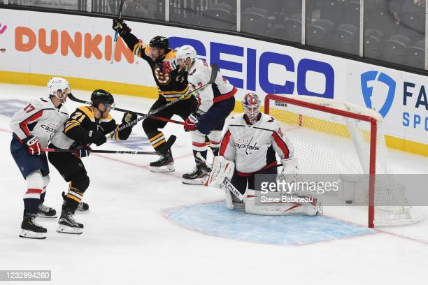 Craig Smith of the Boston Bruins scores in double overtime against the Washington Capitals in Game Three of the First Round of the 2021 Stanley Cup...
