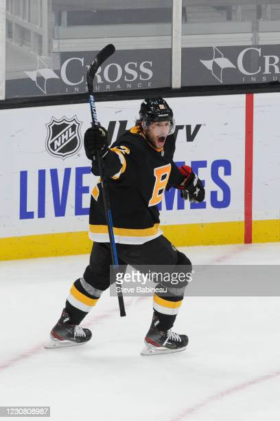 Craig Smith of the Boston Bruins scores in overtime against the Pittsburgh Penguins at the TD Garden on January 26, 2021 in Boston, Massachusetts.