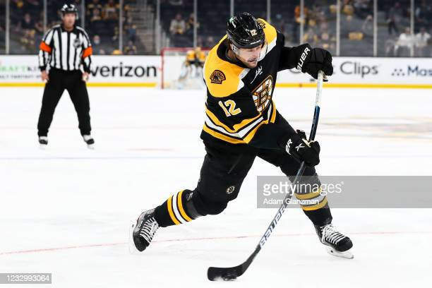 Craig Smith of the Boston Bruins shoots the puck in Game Three of the First Round of the 2021 Stanley Cup Playoffs against the Washington Capitals at...